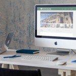 Ufficio con computer con browser aperto sul sito web di Mancini RE Immobiliare